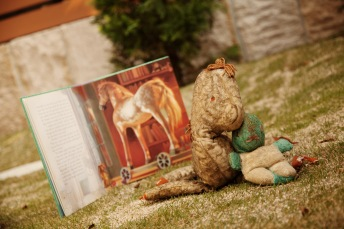 "My dads childhood toys, Old Horsey and Old Bunny in front of my favorite story, ""The Velveteen Rabbit""!"