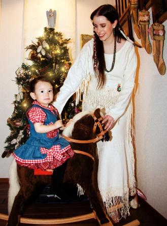 Mama helping Sara Rose on her brand, new rocking horse
